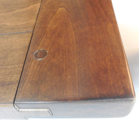 This photo is the result of too high humidity on a plank top table. [Amish Direct Furniture]