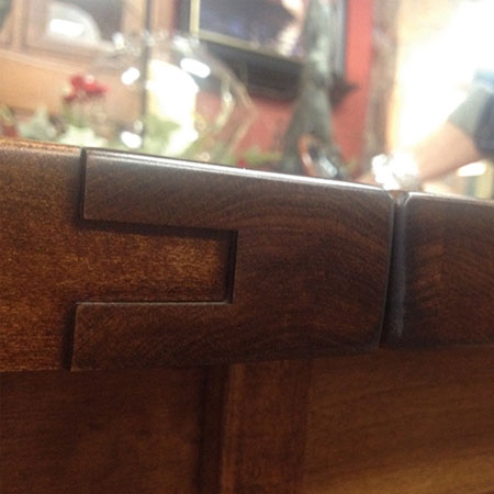 This photo is the result of too low humidity on a plank top table. [Amish Direct Furniture]